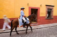 Hispanic man in military outfit on horse