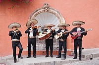 Mariachi band playing in front of fountain