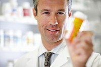Pharmacist Holding Pill Bottle (thumbnail)