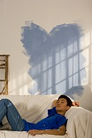 Asian man in partially painted room