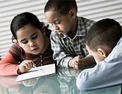 African siblings doing homework