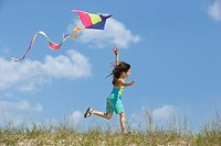 Hispanic girl flying kite (thumbnail)