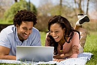 African American couple looking at laptop