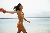 South American woman walking on beach