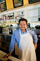 Hispanic cafe owner at counter