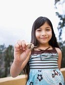 Hispanic girl holding snail