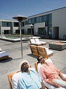 Senior African couple relaxing in deck chairs