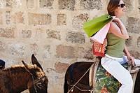 Woman Riding on a Donkey