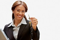 Hispanic businesswoman holding keys