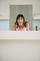 Woman leaning on counter