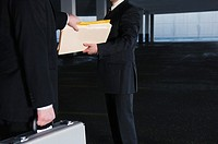 Businessmen trading documents