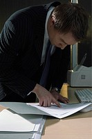 Businessman snooping through documents