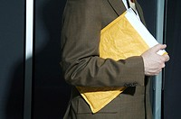 Businessman carrying an envelope
