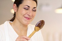 Cook with chocolate_covered wooden spoon