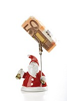 Santa Claus Figurine holding Euro note