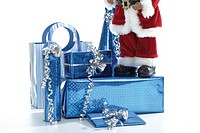 Santa claus figurine with christmas gifts (thumbnail)