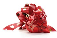 Red gift ribbon with heart-shaped Christmas tree decoration