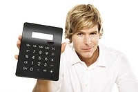 Man holding calculator, close-up