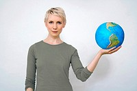 Woman holding earth ball in hand, close-up
