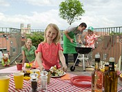 Family on balcony, daughter filling plate