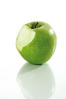 Fresh green apple, bitten inside