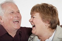 Middle_aged couple laughing close_up
