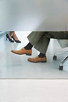 Office workers sitting in office low section feet