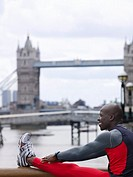 Man stretching in front of Tower Bridge England London