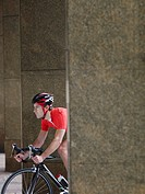 Man cycling between pillars