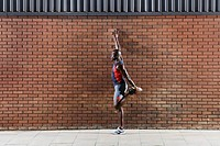 Man stretching by wall