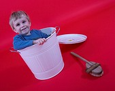 little boy sitting in white tub