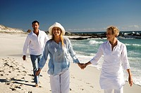 Couple and senior woman on the beach