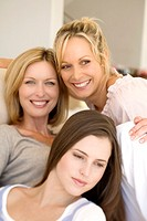 Three smiling women, indoors