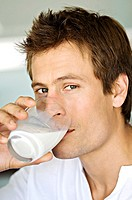 Portrait of a man drinking glass of milk