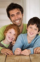 Father and 2 children smiling for the camera (thumbnail)