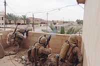 Camp Corregidor, Ramadi, Iraq. (May 20, 2006) Corporal Jeremy Rugg attached to 2nd Air Naval Gunfire Liaison Company (ANGLICO) with Corporal Julius Mi...
