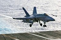 PACIFIC OCEAN (June 23, 2006) - An F/A-18C Hornet of Strike Fighter Squadron (VFA) 195, t he 'Dambusters,' prepares to land on the flight deck of USS ...