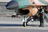 A maintainer from the 64th Aggressor Squadron at Nellis Air Force Base, Nevada, preps an ´enemy´ F-16 Fighting Falcon April 10 prior to a mission duri...