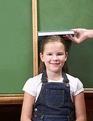A student being measured in front a chalkboard (thumbnail)