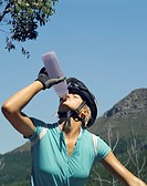 A woman drinking a bottle of water (thumbnail)