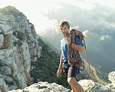 A mountain climber carrying his gear