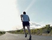 A man running along a rural road