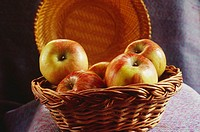 Fruits , Apples in cane basket