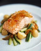 Salmon with mustard fruit, courgettes and potatoes Italy