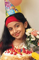 South Asian Indian girl celebrating birthday holding bouquet of flowers MR361