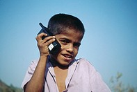 South Asian Indian boy talking on mobile phone , bombay mumbai , maharashtra , india