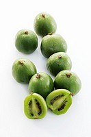 Baby kiwi fruits, one halved