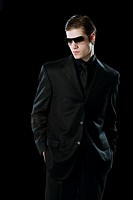Man wearing a suit and sunglasses