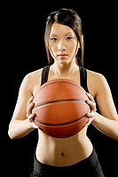 Woman holding basketball