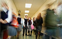 Standing still in a busy high school hallway